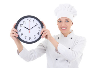 young happy woman chef in uniform holding office clock isolated