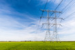 Power lines and pylons in a rural landscape - 71768799