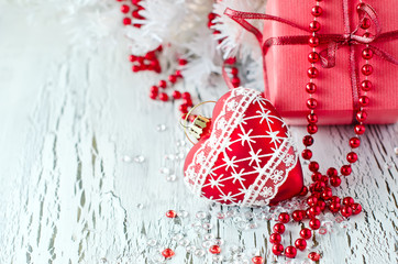 Christmas red present box with a heart decoration copy space
