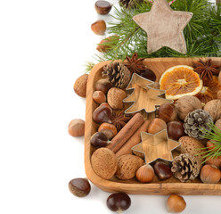 Various nuts in a wooden bowl