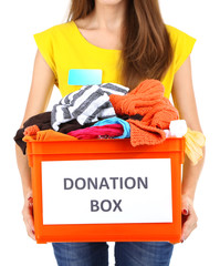 Girl volunteer with donation box  isolated on white