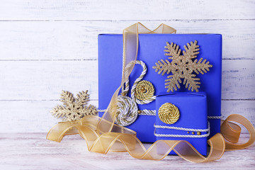 Blue holiday gift boxes and ribbon