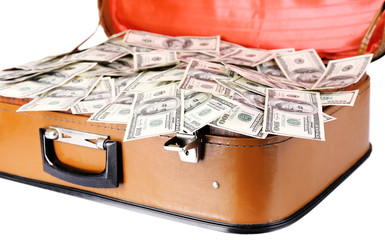 Lot of one hundred dollar bills in old suitcase isolated