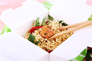 Chinese noodles and sticks in takeaway box