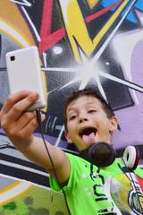 Teen boy with headphones and smartphone
