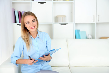 Psychiatrist keeping record during therapy session