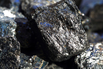 Black tourmaline an aquamarine crystal black background