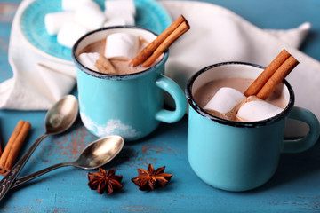 Cups of tasty hot cocoa, on wooden table