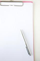 white paper on clip board