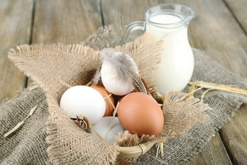 Eggs and fresh milk in glass jug,