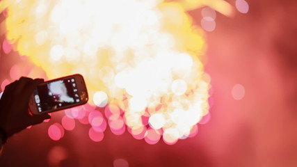 Making video with cell phone at fireworks display.