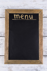 Inscription menu on chalkboard on table close-up