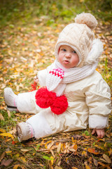 emotions of the beautiful little girl in the autumn wood