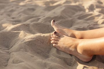 Young woman's feet on the beach