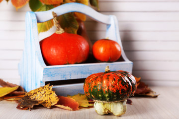 Pumpkins in wooden box and leaves