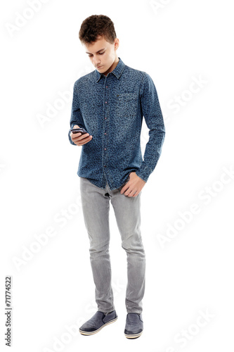 Teenager texting on his smartphone - 71774522