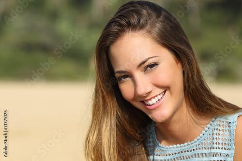 Leinwanddruck Bild Woman with a white teeth smiling