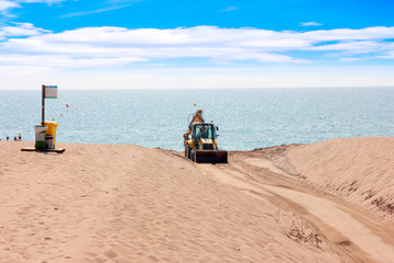 cleaning special tractor sandy beach sea coast