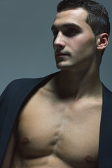 Male beauty concept. Portrait of fashionable and undressed young