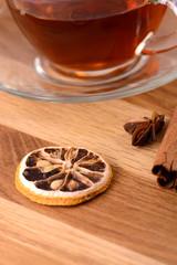 hot tea with lemon and cinnamon on wooden backgroubd