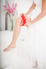 Young Bride Putting On Red Grater