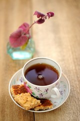 Black tea in a cup with cookies