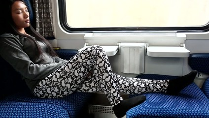 woman sitting comfortably in a train