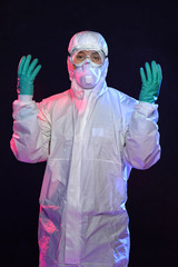 Man in Hazmat Suit with Gloves and Goggles