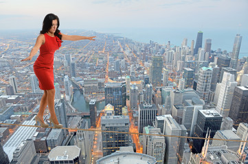 Businesswoman Walking on Tightrope