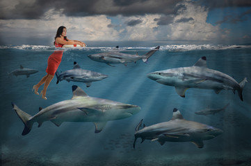 Competitive Business Concept With Businesswoman and Sharks