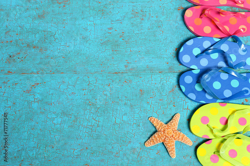 canvas print picture Sandals and Starfish on Wood Planks