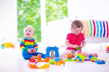 Beautiful children playing with toy cars