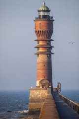 Lonely lighthouse on the top of breakwater