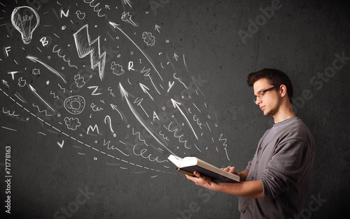 Young man reading a book - 71778163