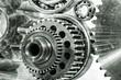 cogwheels, gears and machinery against titanium