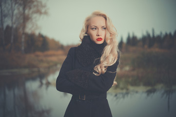 Beautiful elegant woman in a black coat