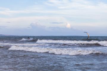 Unidentified people during demonstration of kitesurfing