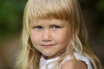 Portrait of a little blonde girl