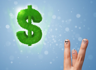 Happy smiley fingers looking at green leaf dollar sign