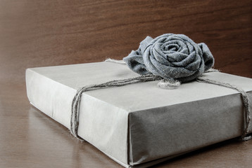simple stylish box on the wooden background with rose