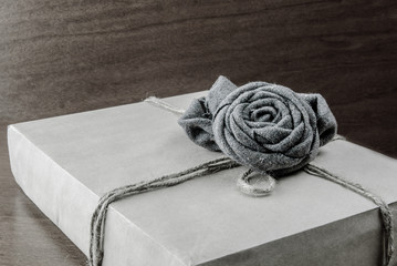 box with a rose gray woolen rope wrapping paper