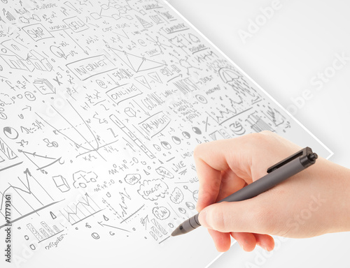 canvas print picture Human hand sketching ideas on a white paper