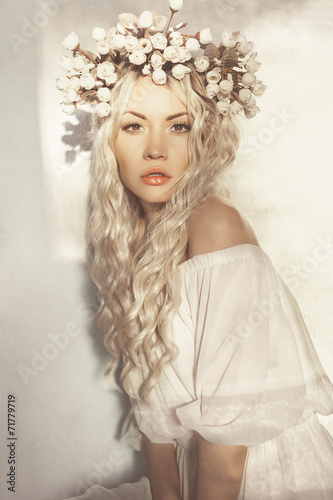 Beautiful blonde with wreath of flowers - 71779719
