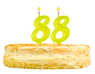birthday cake with candles number eighty eight isolated on white