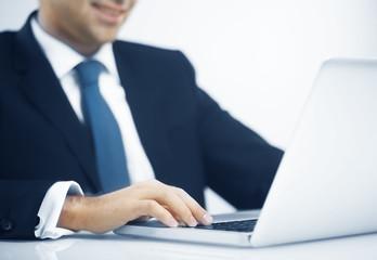 man pushing keys of laptop