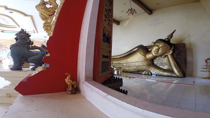 A reclining buddha statue at a temple in Rayong city , Thailand