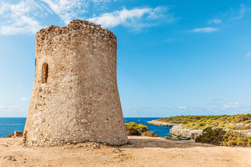 Medieval watchtower on the coast of Cala Pi