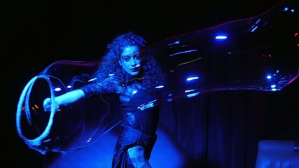 female performer in soap bubbles magician show