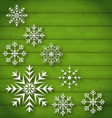 Set geometric snowflakes on wooden background