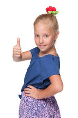 Young girl holds her thumb up
